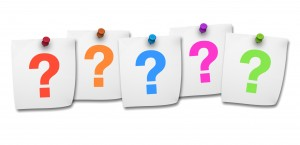 Website, social network and Internet concept with colorful question mark symbol on five post it on white background.